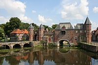 """The Koppelpoort is a medieval gate in the Dutch town Amersfoort. Completed around 1425, it is a well-preserved example of medieval fortification. It is a combination of a land and water-gate and is part of the second city wall of Amersfoort, which was constructed between 1380 and 1450. The gate was opened and closed every day by twelve appointed raddraaiers, """"wheel-turners"""". The wall was last restored in 1996.  Photo: Bert Kaufmann"""
