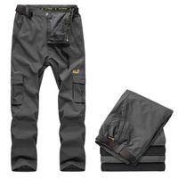 Primavera 2014 a prueba de viento de concha blanda individuales cálidos pantalones de escalada deportiva al aire libre Pantalones nuevos hombres jack senderismo pantalones de piel de lobo