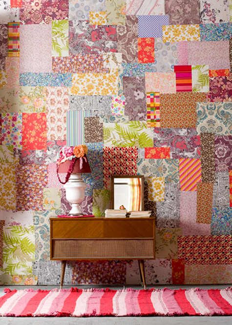 fabric 'quilted' wall! I would possibly do this, but I'd do it on cork maybe or just a small portion of an office or laundry. Neato idea though for a fabricholic like me!