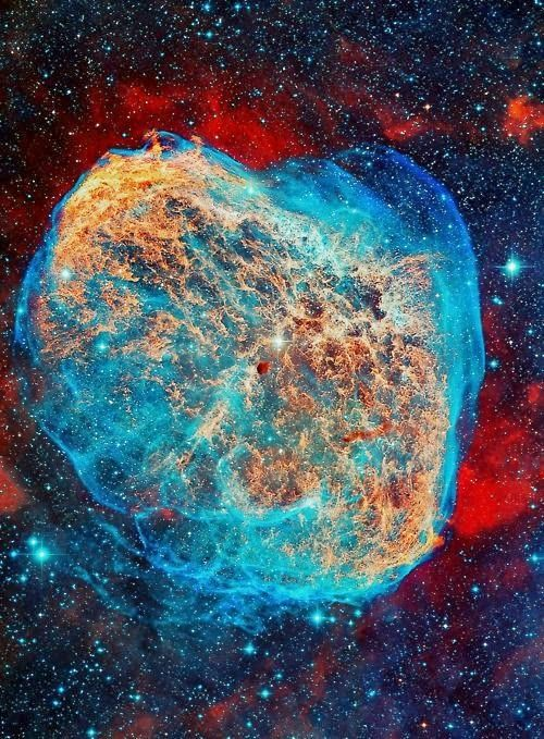 Crescent Nebula (NGC 6888) is an emission nebula in constellation Cygnus - a northern constellation lying on plane of the Milky Way. Hubble colors show emission from sulfur, hydrogen, & oxygen atoms in the wind-blown nebula in red, green & blue hues.