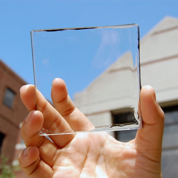 """'Transparent Solar Panel' """"Researchers at Michigan State University have created a solar panel that resembles typical glass, which can be placed on top of a window to collect solar energy, while still providing an unobstructed view. Called a transparent luminescent solar concentrator, the panel uses organic molecules made to absorb invisible wavelengths of light, such as ultraviolet and near infrared light."""" by KEVIN OHANNESSIAN techtimes.com"""