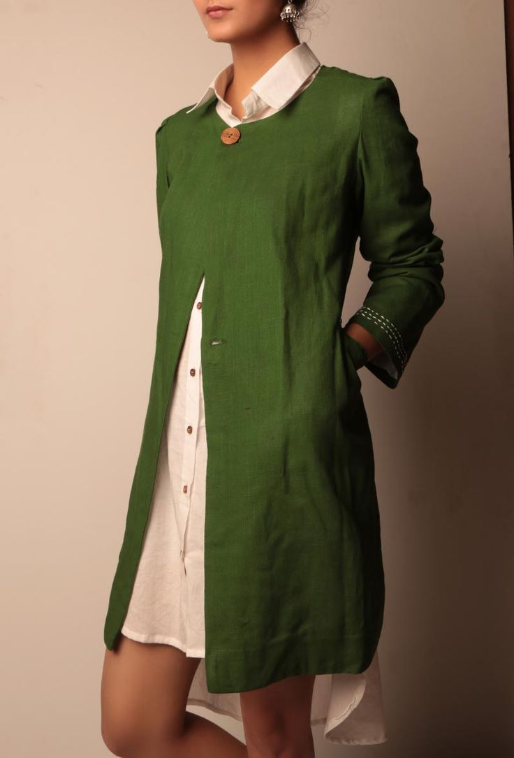 "Green cotton linen A-line jacket with side pockets, one wooden button clousure and white anchor embroidery detailing Dimension: Available in size XS, S, M, L, XL, XXL & XXXL Length of the Jacket : L: 35 Inch Length of Sleeve : 25 Inch Color: Green Lining: Yes Finish: Handcrafted Material: Cotton linen Please note : Model is 5'7"" and is wearing size small & these are custom designed apparel and can be exchanged for any size related issues, not eligible for returns"
