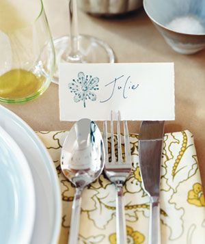 SMART place card holder!  Why bring out more accessories and things to wash or knock over?  Love it!