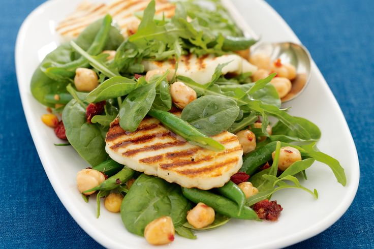 Chickpea, haloumi and rocket salad Beautiful char-grilled haloumi cheese and sun-dried tomatoes add authentic flavour to this Middle Eastern recipe.