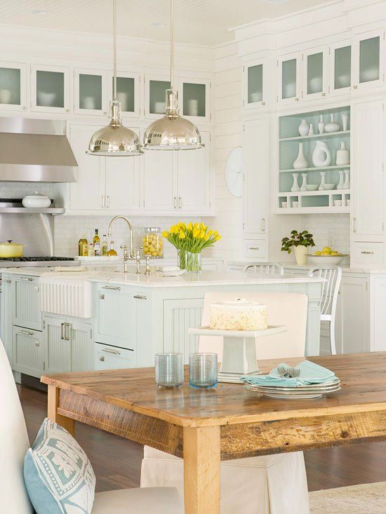 This coastal-inspired kitchen renovation features a farmhouse sink, beaded board cabinetry, and gorgeous subway tile backsplash for a getaway look.