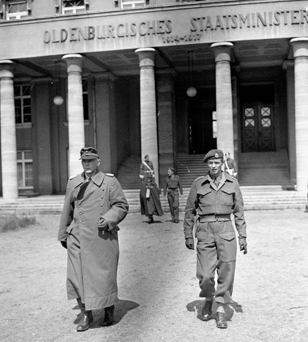 German Major-General Stephan, the commander of Battle Group Stephan in northern Germany, is accompanied by Captain P. Fafard of the 2nd Canadian Infantry Division into a surrender conference, Oldenburg, Germany, Monday, 7 May 1945. (Photographer: Barney J. Gloster; Library and Archives Canada a197988)