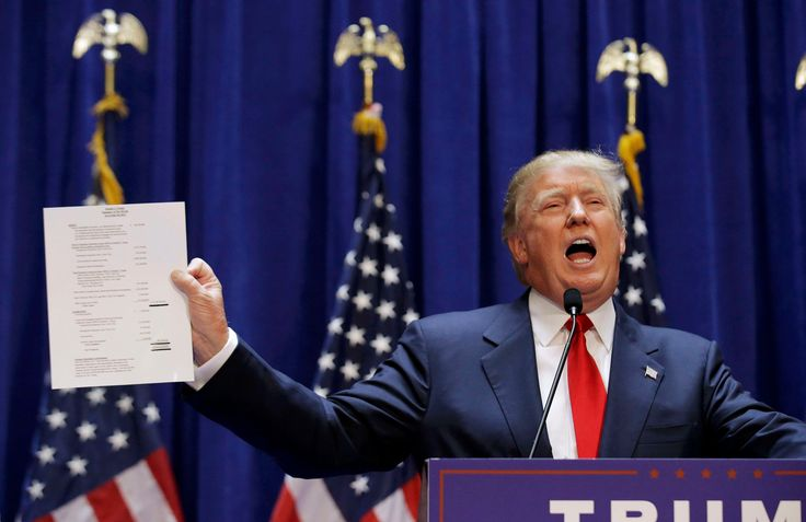 16 June 2016  Trump holds up his financial statement as he formally announces his campaign for the 2016 Republican presidential nomination at Trump Tower in New York