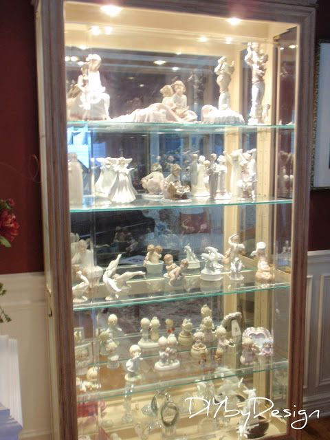 Lladros Figurines In A Display Cabinet Pictures Two