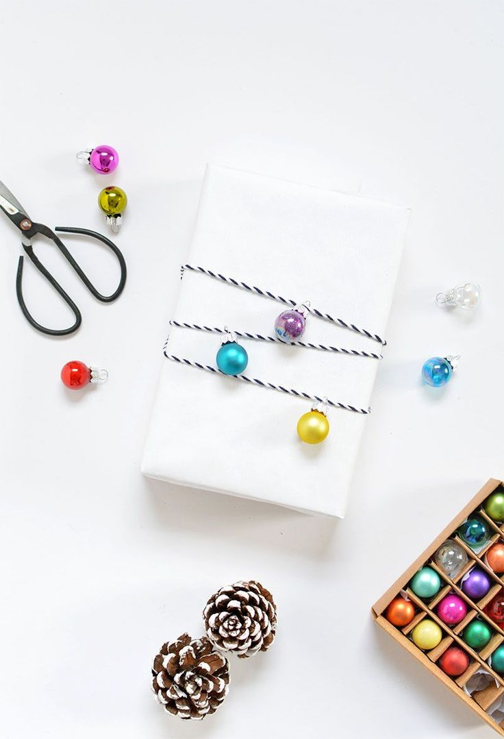 minimal gift wrap- white paper and baubles