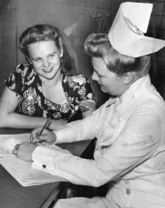 "1947 - ""Registers"" :: George D. McDowell Philadelphia Evening Bulletin Photographs - Mary Pack is being signed up by Nurse Josephine Bacauskis for a course in practical nursing. The location is the Fleisher School."