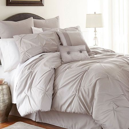 Create a luxe retreat in your master suite or guest room with this lovely comforter set, showcasing chic tufted details and a neutral sand-hued palette.   ...