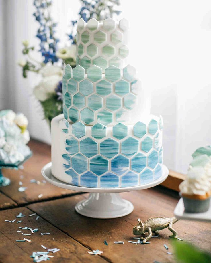 Wedding Cake Design Ideas That'll Wow Your Guests | Martha Stewart Weddings - Geometric shapes, that deepen from pale green to cerulean, bring a touch of the contemporary to this modern wedding cake. #weddingcakes #weddingideas