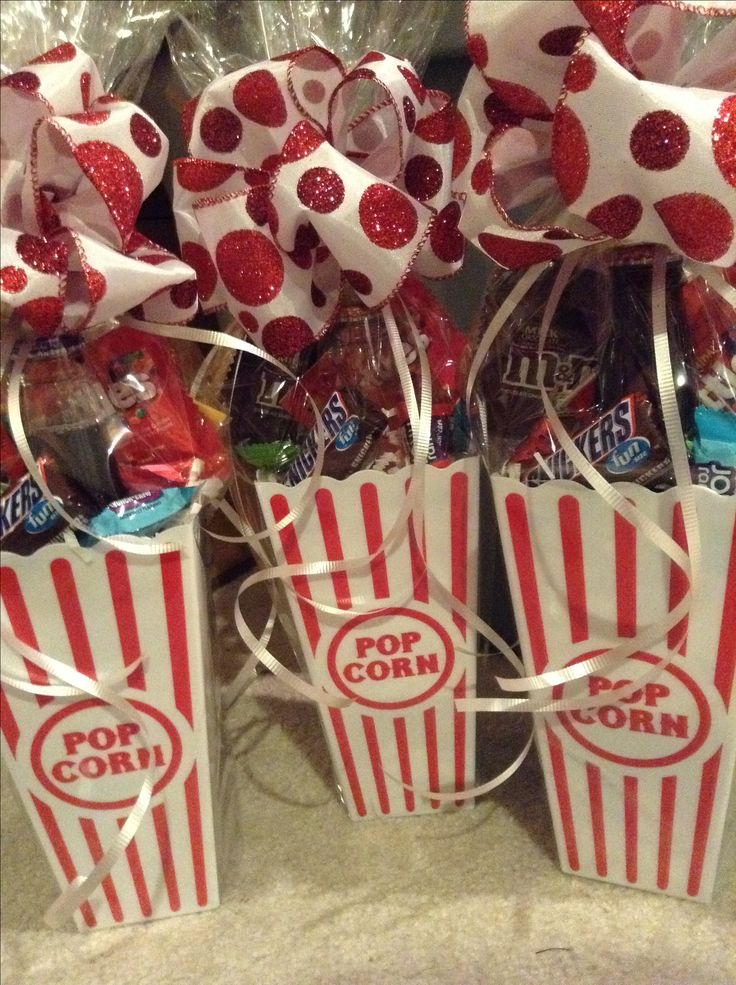 Movie night gift baskets- Include a bottle of soda, skittles, m&ms, jolly ranchers, snickers, and a small bag of microwave popcorn. Built and bowed for $5 each!