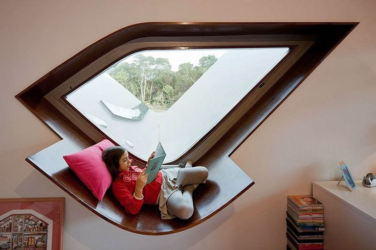 DESIGN DETAIL - A Window Seat For Reading - Bernardo Rodrigues designed a home for a family, and included a unique window seat that is the perfect size for the kids to enjoy some quiet time reading.