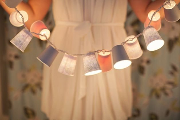 This tutorial for Dixie Cup Light Garland from Hey Gorgeous is both thrifty and lovely! Using paper covered mini cups to create tiny shades for stringed lights is such a great idea for decorating o...