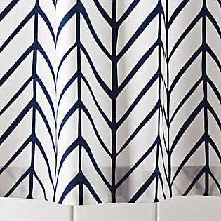 Navy Feather Shower Curtain from Serena and Lily.  Great Herringbone pattern - classic elegance. Also comes with matching towels.