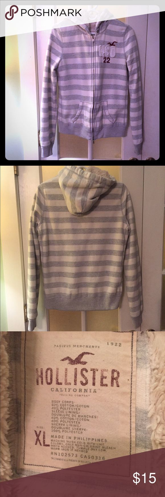 Hollister fur lined striped zip up hoodie Extremely cozy and warm zip up!! Tag reads XL fits more like a medium, Only flaw is the missing hood string slight piling... Hollister Tops Sweatshirts & Hoodies