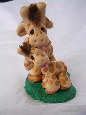 jirafa mama con bebe