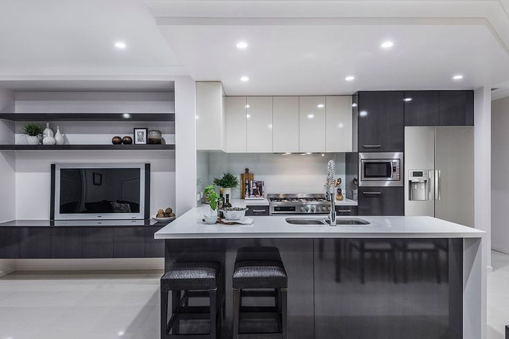 #Kitchen #design #ideas from Ausbuild's Bellfield display #home. www.ausbuild.com.au. This #Kitchen is bright and airy and makes fantastic use of all available space. The #elegant #black #chairs sit perfectly under the strong white #stone #bench #top.