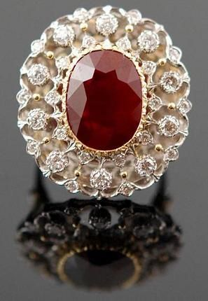 Lace like effect giving the traditional cluster ring a twist. Ruby and diamonds. 18K gold and platinum. Buccellati, Italy. Undated.