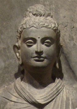 Buddha head from Gandhara region. This Greco-Buddhism style is a cultural syncretism between the Classical Greek culture and Buddhism which developed in the 1,000 years between between the conquests of Alexander the Great in the 4thC BC, and the Islamic conquests of the 7thC AD in central Asia. It is characterized by the strong idealistic realism and sensuous description of Hellenistic art and the first representations of the Buddha in human form.