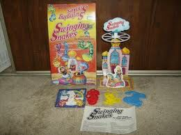 """Swinging snakes game- original is better quality than the recent release from Walmart for $5. I play this game to introduce /s/  and s-blends. Target words are """"spin, snake, small, circle, same, phrase level - I want to spin, red snake etc..."""