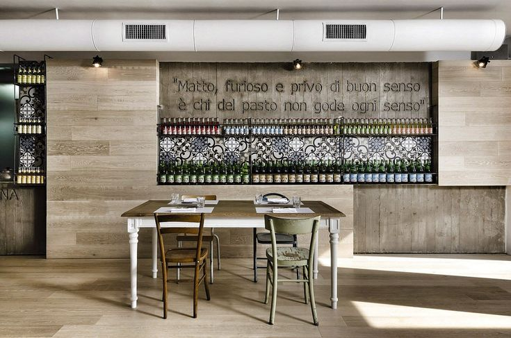 This rustic yet contemporary restaurant by Noses Architects is a 2012 project located in Lazio, Italy. It is a reinterpretation of the traditional tavern and pizzeria. Photos by: Mohamed Keilani