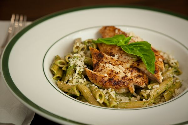Quick sautéed boneless, skinless, chicken breasts tossed with basil pesto and whole wheat pasta. Make your own pesto, it's easy and tastes better than the store stuff.