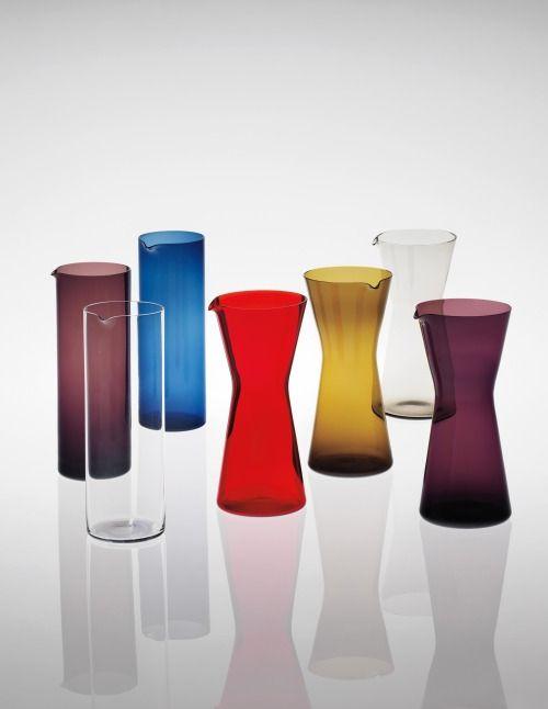 Kaj Franck. Group of seven carafes, 1955-1960.Coloured glass. Produced by Nuutajärvi Notsjö, Finland.
