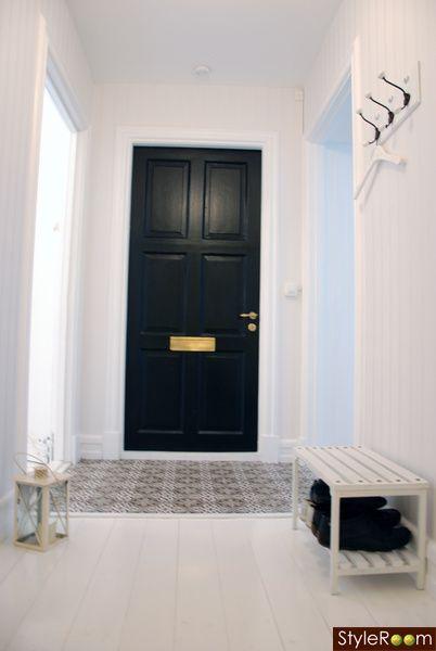 love the mosaic floor and black door!