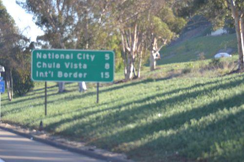 tiajuana usa border | ... Border road sign before the Tijuana Mexico, San Ysidro border