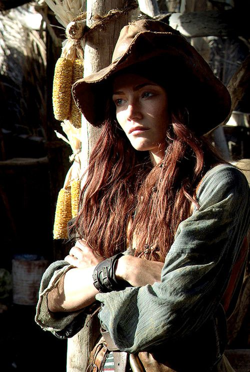 """Anne Bonny as played by Clara Paget in Black Sails.  The real Anne Bonny, born 1702, Kinsale, Ireland, and was a famous female pirate operating in the Caribbean. She sailed with Captain Jack """"Calico Jack"""" Rackham, on the pirate sloop Revenge. Captured in 1720, Anne and her fellow pirates were taken to Jamaica and sentenced to hang but Anne disappeared only to surface later in South Carolina. She died there 22 April 1782."""