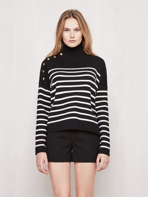 Sailor-style short jumper MONTAUBAN. Crafted in knit, the jumper is adorned with delicate two-tone sailor-style stripes. It features a high collar, with a slit at the side and decorated with golden metal press studs. Short, slightly loose cut. Perfect for wearing with jeans, accessorised with a pair of high-heeled ankle boots for a casual modern style!