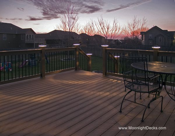 Deck lighting using low voltage lighted post caps under railing led lights and step