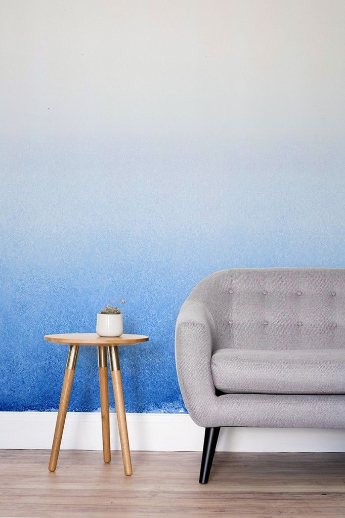 Banish dull and boring walls with this beautiful ombre wallpaper mural. It adds colour to your living room in an understated and stylish way.