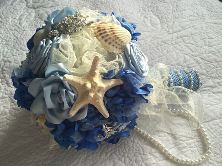 This bouquet is great for a beach themed wedding, featuring various different blue flowers, natural sea shells and Swarovski brooches.  The bouquet is finished off with some pearls dropping down from the bouquet edge.  All bouquets can be reproduced in the size and colour of your choice. Feel free to mix and match ideas to make your bouquet more individual. Corsage, MOB and Lapel pins are also available to match your colours. Contact leeann@bejewelledbridal.com.au for more information.