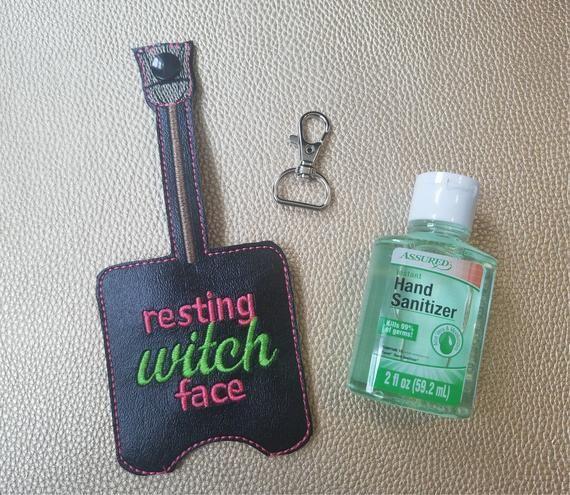 Resting Witch Face Key Chain Witch Hand Sanitizer Holder