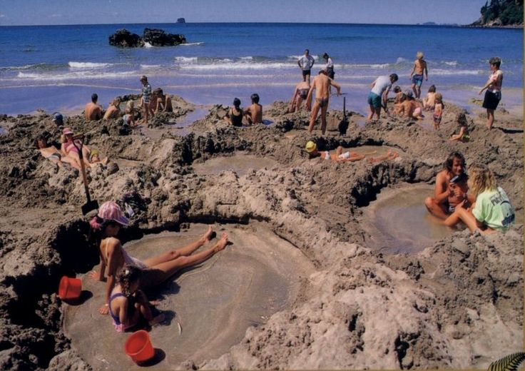Hot Water Beach, between Tairua and Whitianga, Coromandel., N.Z. Two hours either side of low tide, with the help of a spade you can dig your own natural hot pool. These hot springs come from an underground river, heated under the earth and seeping to the Pacific Ocean.