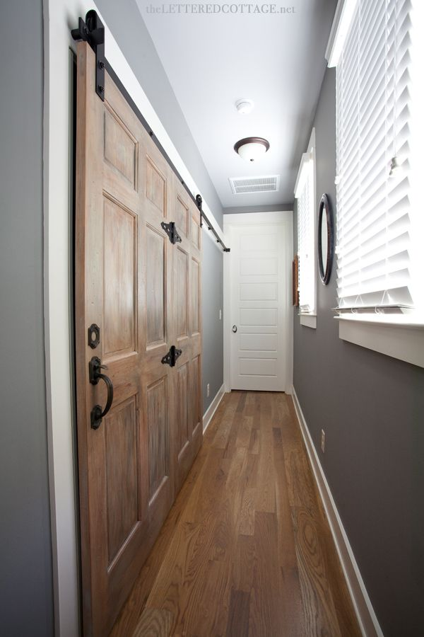 Rustic meets refined upstairs hallway laundry sliding for Narrow barn door