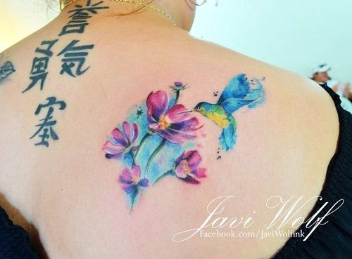 Flower & bird watercolor tattoo on girl's back