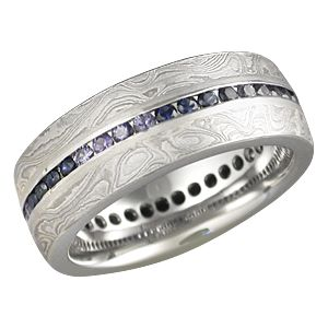 This is a mokume wedding band and a diamond eternity ring in one - although I'd prefer it with peridot or emeralds