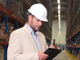 industrial engineer making notes in warehouse