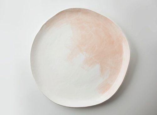 Peach Watercolor Platter This 11.5 inch white platter is decorated with a wash of soft peach brush strokes. Fully glazed, this platter can be used safely with food. I advise hand washing to avoid chipping the piece.