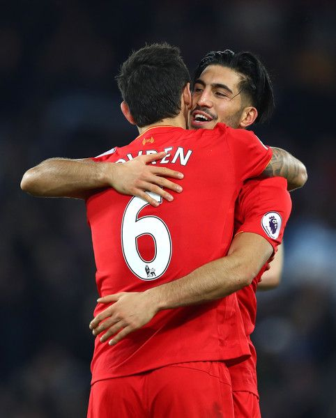 Dejan Lovren of Liverpool and Emre Can of Liverpool celebrate victory during the Premier League match between Liverpool and Manchester City at Anfield on December 31, 2016 in Liverpool, England.