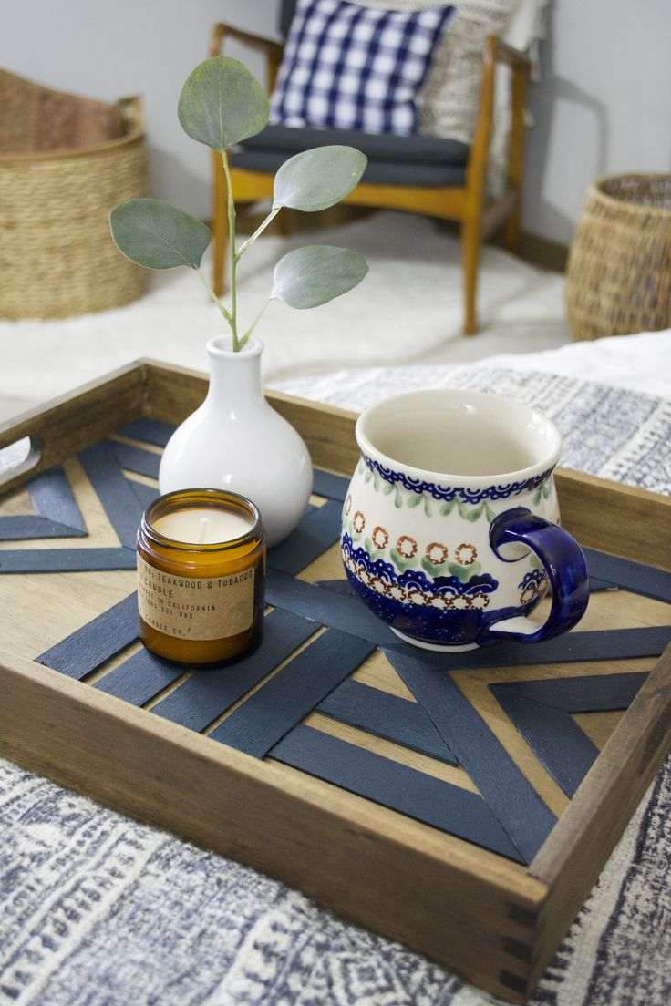Create this DIY Geometric Serving Tray by using balsa wood and Behr paint to create a fun patterned piece of decor that's pretty and functional!