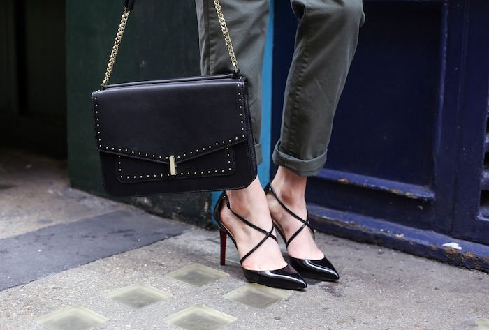 Christian Louboutin black pumps and REISS handbag