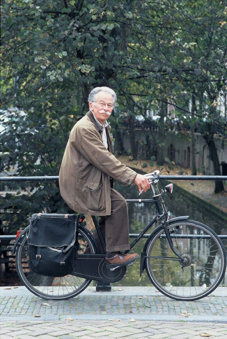 Dick Bruna on a bicycle.   Creator of Nijntje.