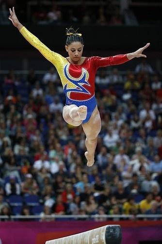 Colombian gymnast Jessica Gil Ortiz wears a pretty bow instead of a scrunchie.