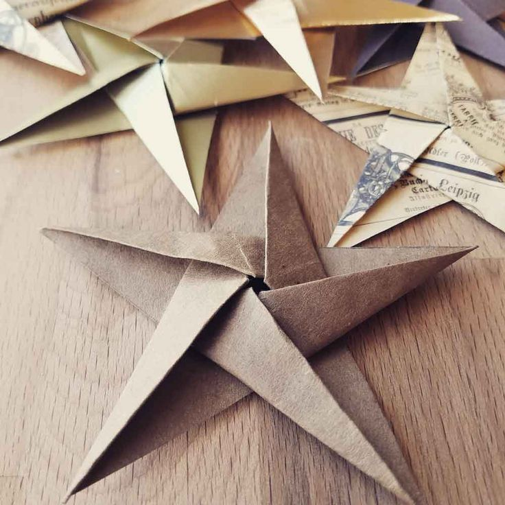 cheap and easy DIY Christmas Ornaments Origami Star made with brown paper bags- folded origami paper goup pic