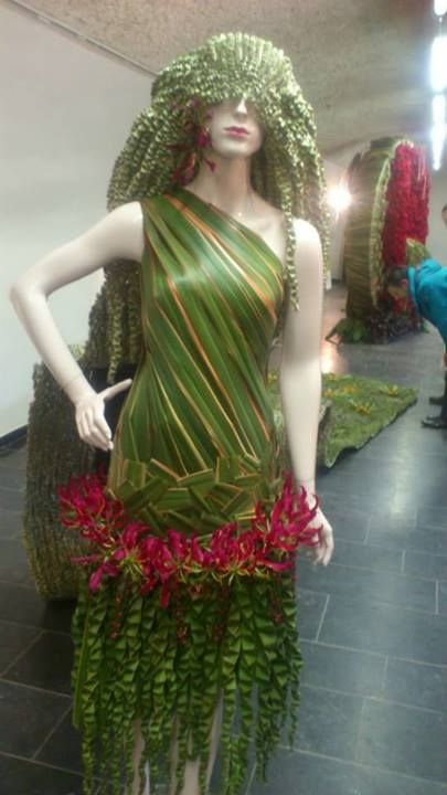 One-shouldered dress made with green leaves and red flowers https://scontent-a-lga.xx.fbcdn.net/hphotos-prn2/q71/s720x720/1237088_10201661336282765_2090053881_n.jpg